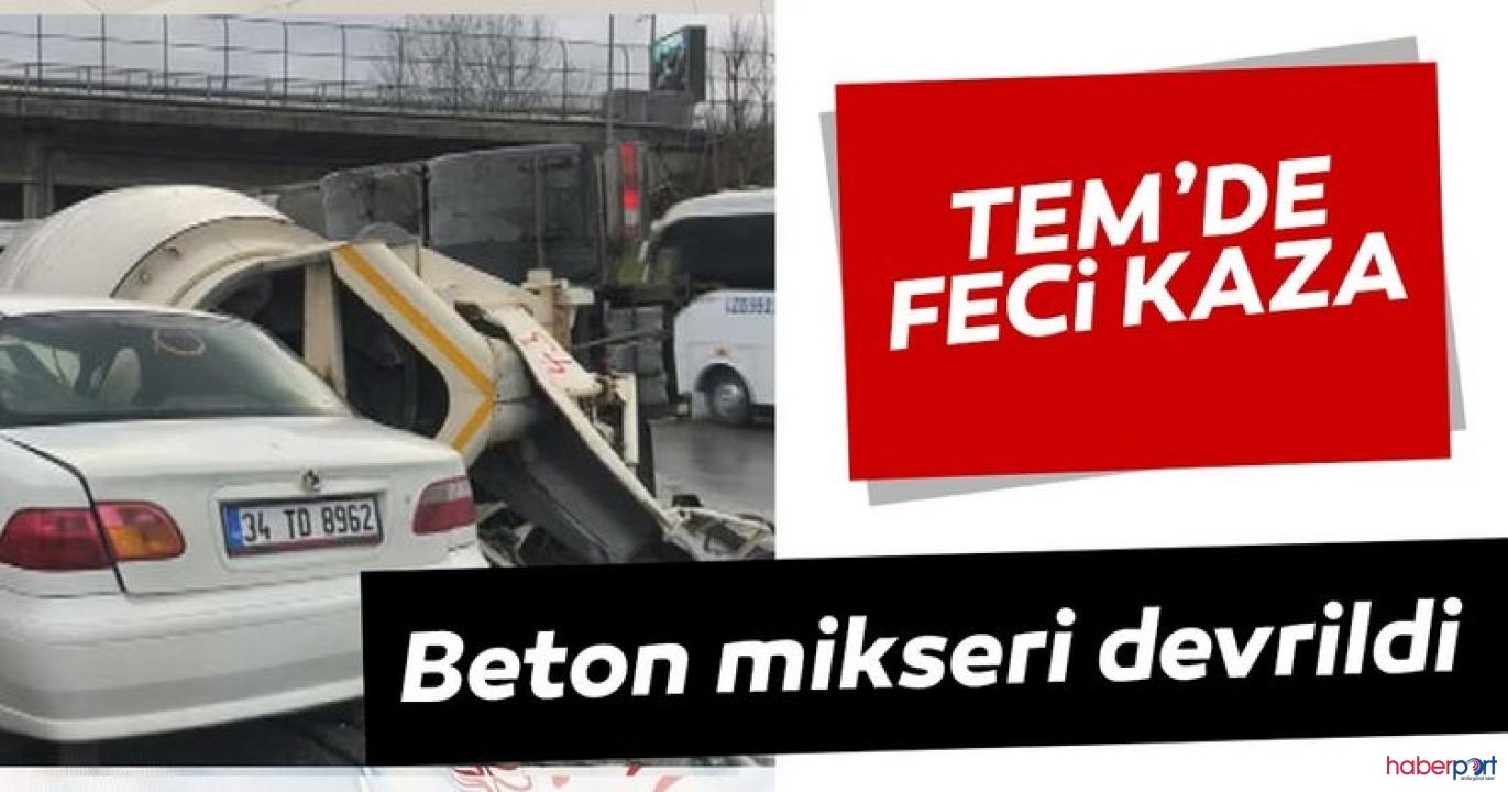 Bağcılar TEM'de virajı alamayan beton mikseri otomobilin üzerine devrildi