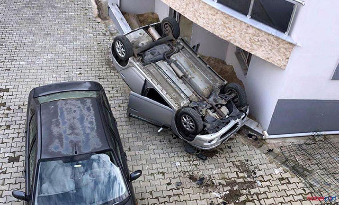 10 metreden site bahçesine düşen otomobil 2 kişiyi yaraladı