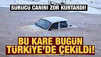 Eksi 18'i gören Adana'da suya kayarak düşen otomobil buz tuttu