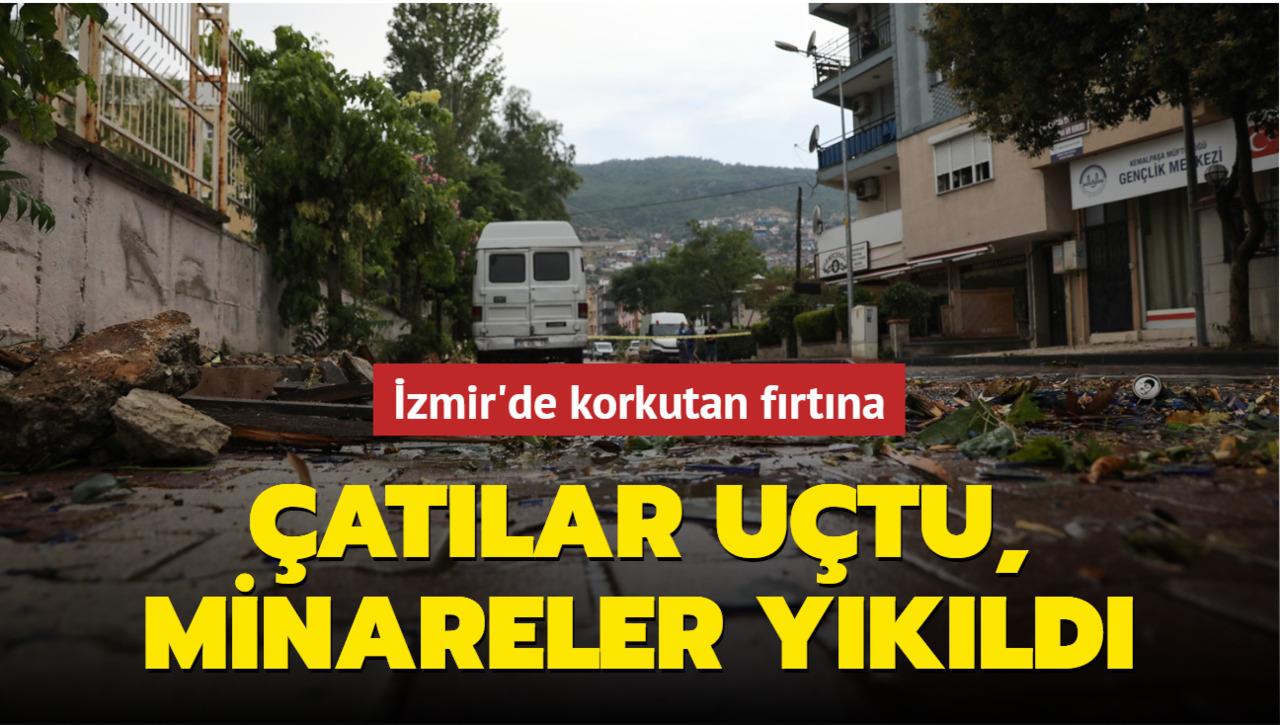 İzmir'de kısa süreli yaşanan  fırtına vatandaşlara zor anlar yaşattı